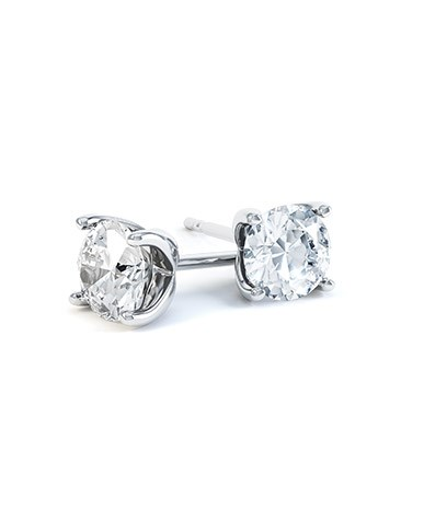 A pair of Round Diamond Stud Earrings