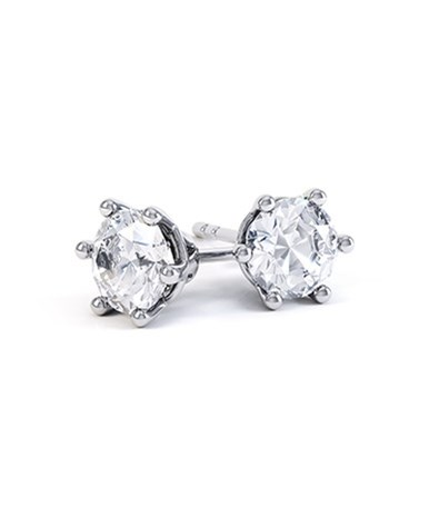 A pair of Six Claw Round Diamond Stud Earrings