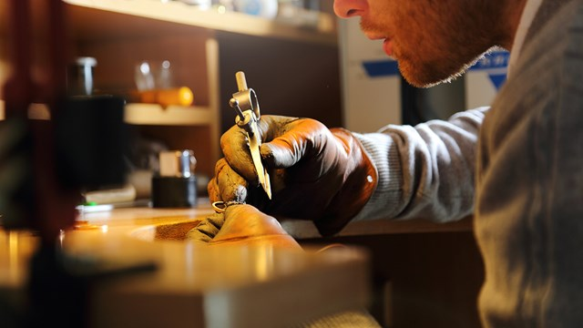 A jewellery craftsman making a ring